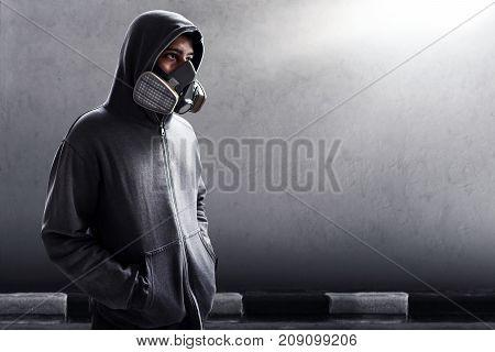 Man wearing respirator mask on the street