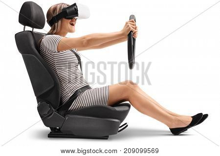 Woman with a VR headset sitting in a car seat and holding a steering wheel isolated on white background