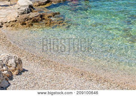 Rocky beach, bue transperent, sea and islands in Istria, Croatian coast