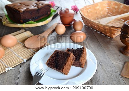 Taiwanese chocolate sponge cake on white plate at wooden board