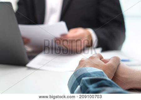 People having meeting in office. Boss with a job applicant in interview. Lawyer with client. Business man or bank worker having discussion about loan or insurance. Financial advice. Giving feedback.