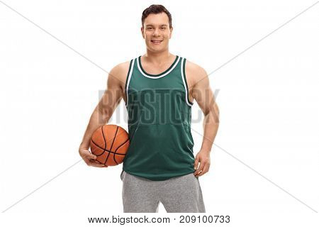 Young man dressed in a green jersey holding a basketball isolated on white background