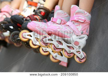 Legs of girl on rollers at skate park