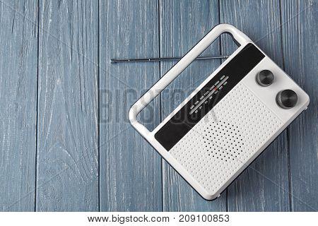 Radio receiver on wooden background