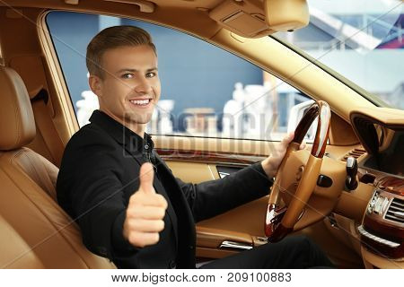Young man on driver seat of car
