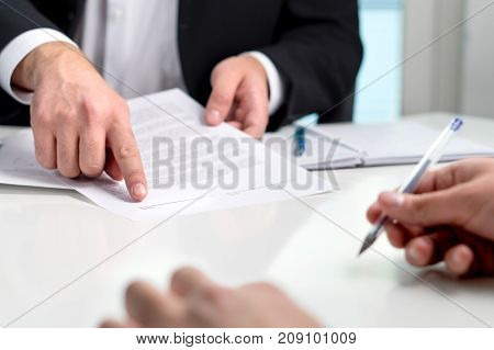 Man holding a legal document in hand. Lawyer holding law paper in office. Scale and justice symbol.