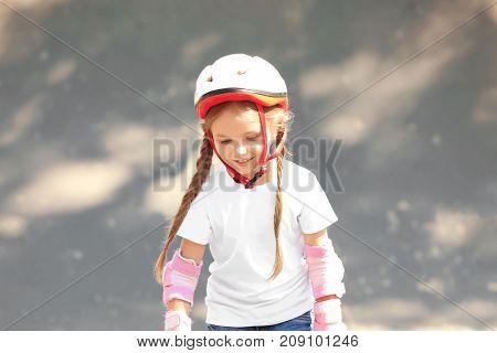 Cute girl rollerblading in skate park