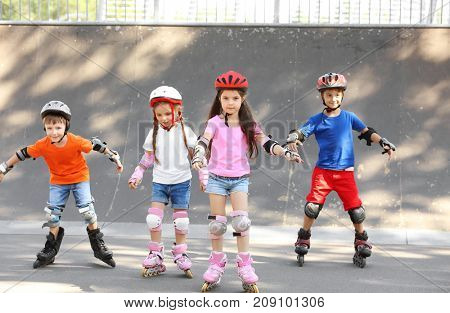 Active children rollerblading in skate park