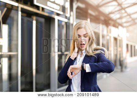 Young businesswoman standing outdoors