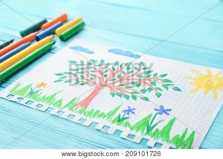 Child's drawing of tree on wooden table, closeup