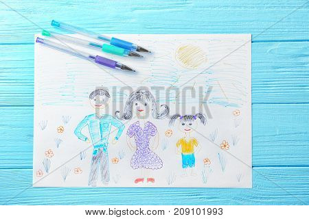Child's drawing of family on blue background