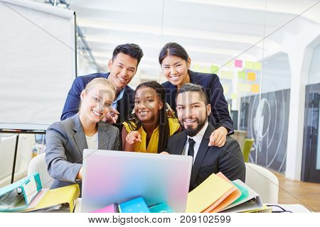 Start-up team group with computer working together at office