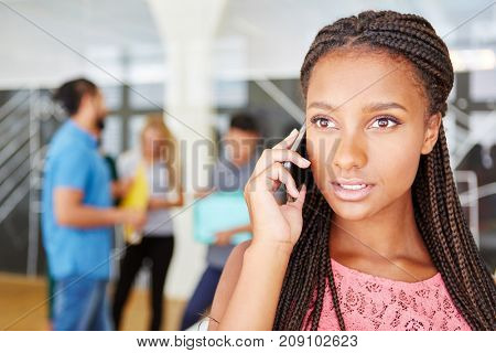 Young woman calling the servicing line at start-up company