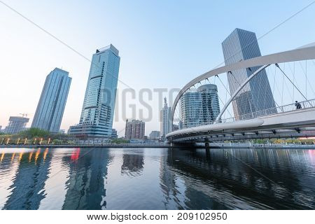 Tianjin city waterfront downtown skyline over Haihe river,China.
