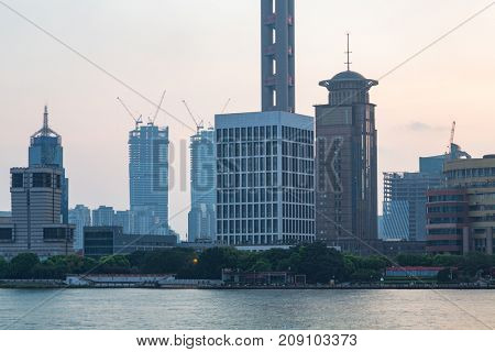 waterfront skyline with construction site,shanghai,china.