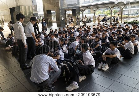 Kyoto, Japan - May 21, 2017: Class of schoolchildren in uniform waiting in the Kyoto station