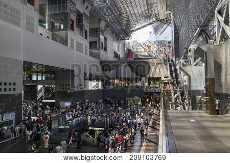 Kyoto, Japan - May 20, 2017:  Interior of the crowded train station in Kyoto, it is a major railway station and transportation hub, designed by Hiroshi Hara