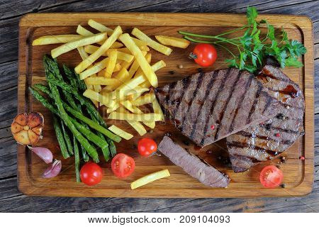 Tasty Hot Beef Steaks With Vegetables