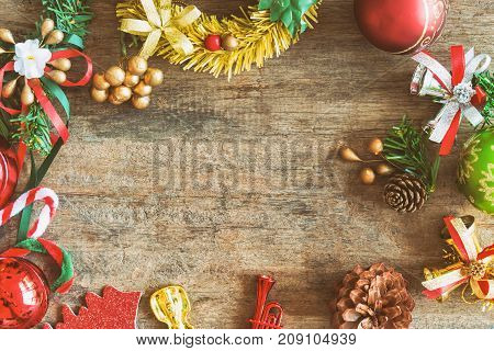Christmas theme background in vintage tone. Rustic wood background for Christmas with copy space for your design. Old wood texture decorated with Christmas theme use for wallpaper and product display. Christmas theme background.