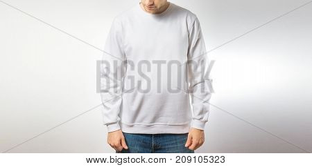 the guy in the blank white sweatshirt stand smiling on a white background mock up free space logo design template for design print