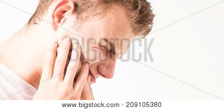 Toothache medicine health care concept Teeth Problem young man suffering from tooth pain caries In a white t-shirt on a white background pain in the jaw