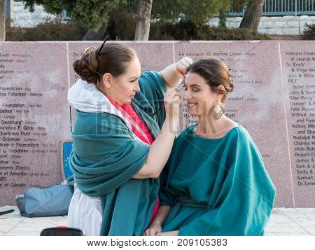 Jerusalem Israel September 16 2017 : The make-up artist makes makeup for the model before shooting at Mt. Scopus in Jerusalem in Israel