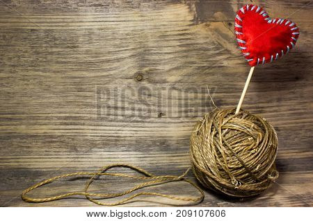 The coils of jute rope on wooden background. Free space for text.
