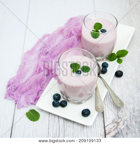 Glasses With Blueberry Yogurt On A Table
