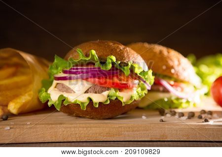 Closeup Of Traditional Cheeseburger Or Hamburger And French Fries