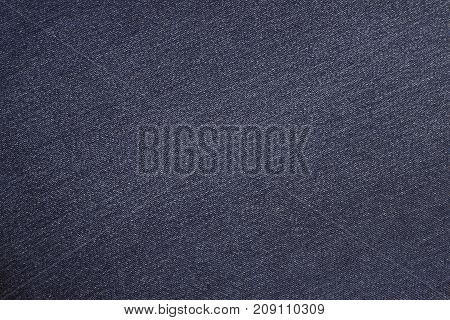 The texture of the jeans is blue. Background of blue jeans material