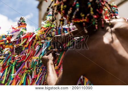 Brazilian man making a wish with the colorful religious brazilian ribbons