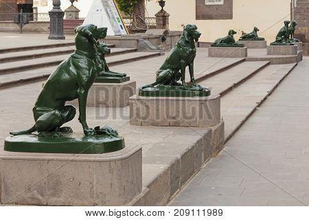 Las Palmas, Grand Canary, Spain - July 1, 2011: Dog statues on Plaza de Santa Ana, main town square of Las Palmas de Gran Canaria