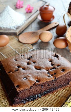 Taiwanese chocolate sponge cake with bamboo weaving basket on wooden board
