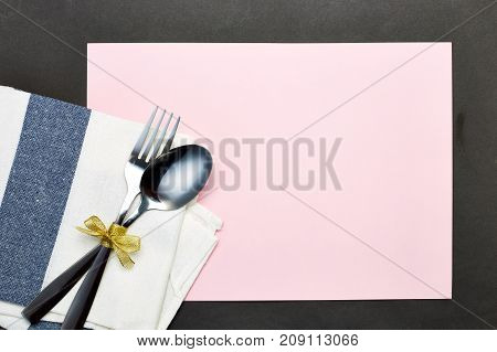Silver Spoon And White Napkin On Pink With Gray Background