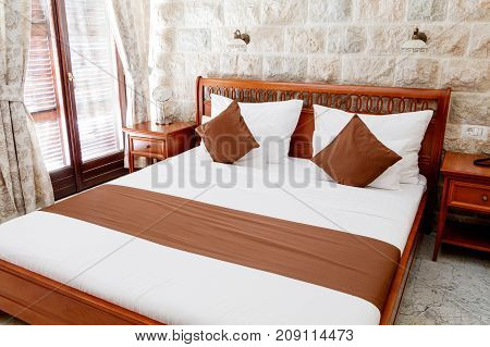 Hotel room with modern interior bed brown