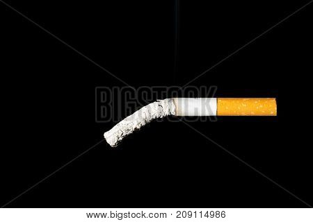 The cigarette end is breaking down. Impotence concept.