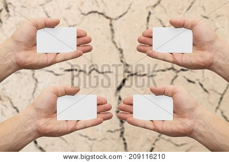 white card in hand   . Photos in the studio