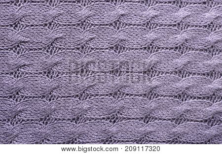 Pale purple knitting wool texture. Warm handmade background