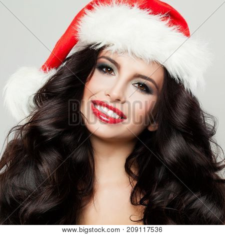 Young Beautifu Brunette Girl in Christmas Hat Smiling Closeup New Year Portrait