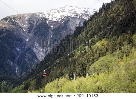 The view of a cable car going up to Mount Robert and Juneau Mountain in a background (Juneau Alaska).