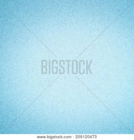 Abstract Decorative Light Blue Background with dark vignette. Granular Texture. Beautiful Christmas Paper With Copy Space for design. Square Wallpaper
