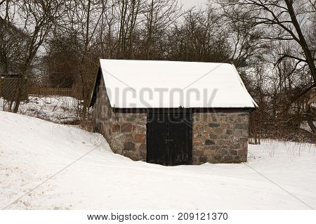 Small shack made of rocks in the snow