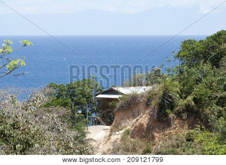 The house built on the edge of a cliff with a perfect view (Roatan island Honduras).