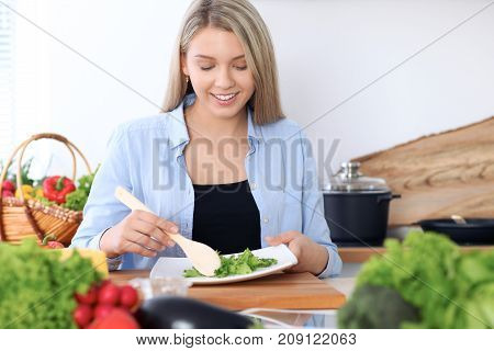 Happy women cooking in the kitchen. Healthy meal concept