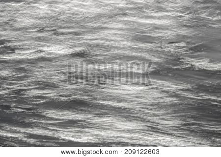 Abstract Look at Ocean Surface With Motion in Silver and White