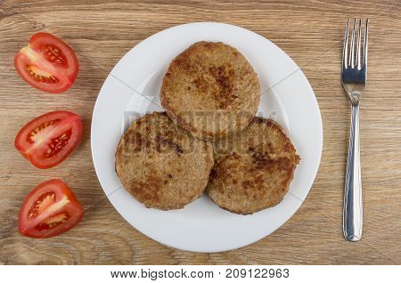 Fried Cutlets In Plate, Slices Of Tomato And Fork