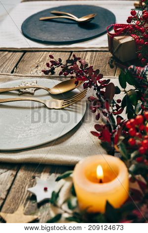 Christmas Table Setting, Golden Cutlery And Wreath Of Nandinas