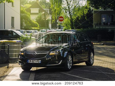 STRASBOURG FRANCE - JUN 27 2017: New black Opel mid-size luxury wagon car parked in a residential district in a French city
