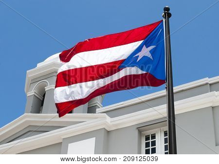The flag of Puerto Rico in the old town of San Juan.