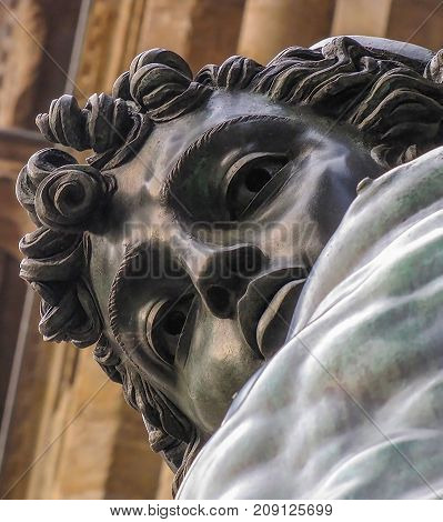 Bronze Perseus Statue Close Up Looking Down at Camera at Piazza in Florence Italy